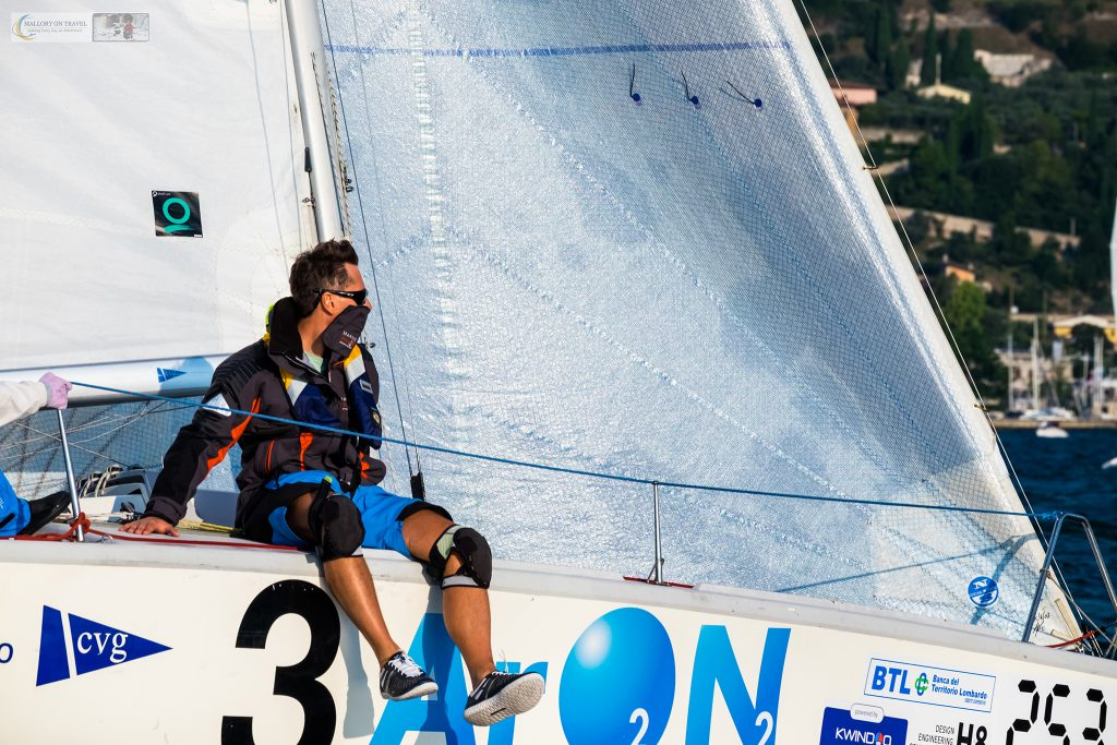 Yacht crew participating in the Centomiglia, a regatta held on Lake Garda in the Lombardia region of Italy on Mallory on Travel adventure travel, photography, travel iain-mallory_garda-1-25