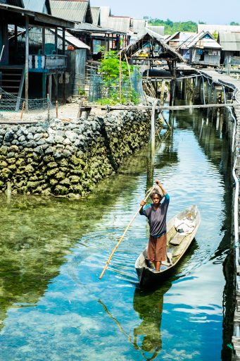 A Bajo woman poles through the Pulau Hoga village in Wakatobi, in Sulawesi in Indonesia on Mallory on Travel adventure travel, photography, travel iain-mallory_indo-1-70
