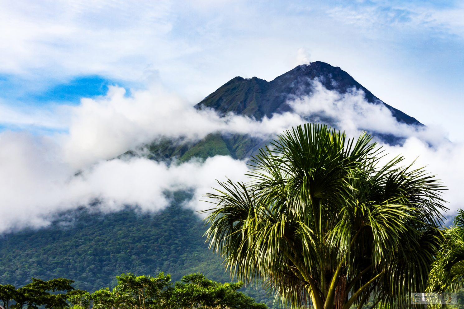 Clouds over Arenal Volcano National Park in Costa Rica from the town of La Fortuna on Mallory on Travel adventure travel, photography, travel Iain Mallory_CostaRica 001-86