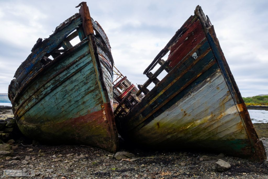 Visual storytelling; Peeling paint of two old fishing boats near Salen in the Sound of Mull on the island of Mull in the west highlands and islands of Scotland on Mallory on Travel adventure travel, photography, travel Iain Mallory_Scotland 003