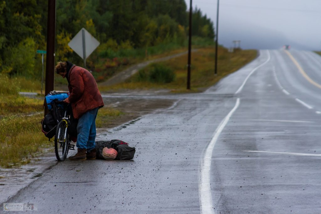Meeting a cyclist outside Whitehorse, capital of The Yukon, Canada on a road trip through the province on Mallory on Travel adventure travel, photography, travel Iain Mallory_Yukon 063