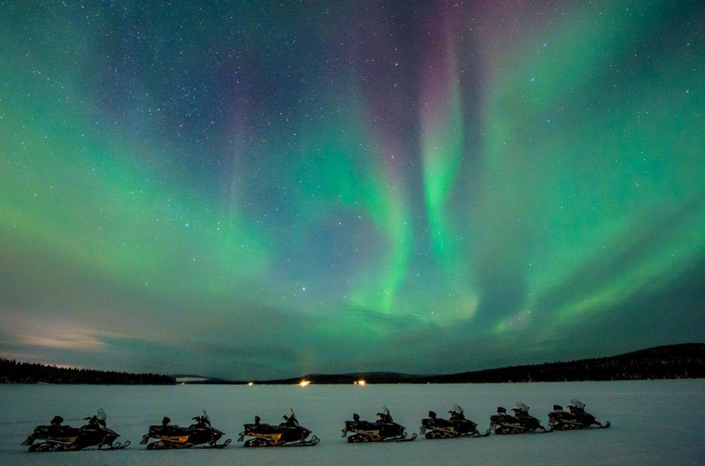 A snowmobiling aurora hunt in Swedish Lapland near the IceHotel on the Torne River, near the village of Jukkasjärvi – 200 km north of the Arctic Circle on Mallory on Travel adventure travel, photography, travel aurora-snowmobile-icehotel-sweden-1400x925