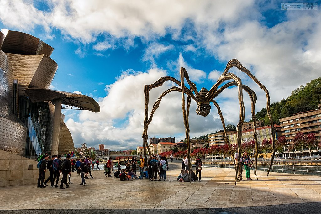 Posing with the Maman, giant spider sculpture by Louise Bourgeois outside the Guggenheim Museum in Bilbao, the Basque Country in Green Spain on Mallory on Travel adventure travel, photography, travel Iain Mallory_Spain 004-2