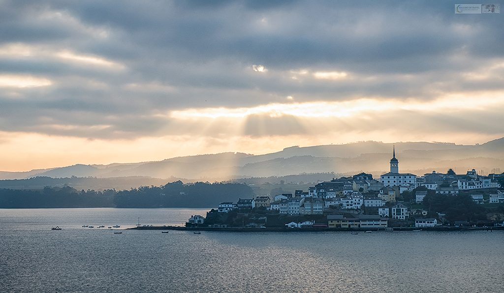 Sunbeams over a town in Asturias looking back from Galicia in the north of Spain on Mallory on Travel adventure travel, photography, travel Iain Mallory_spain-13