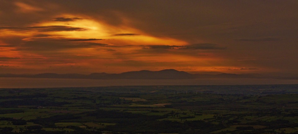 High on Skiddaw in the English Lakeland with sunset over the Solway Firth Copyright © by Mallory On Travel adventure. photography
