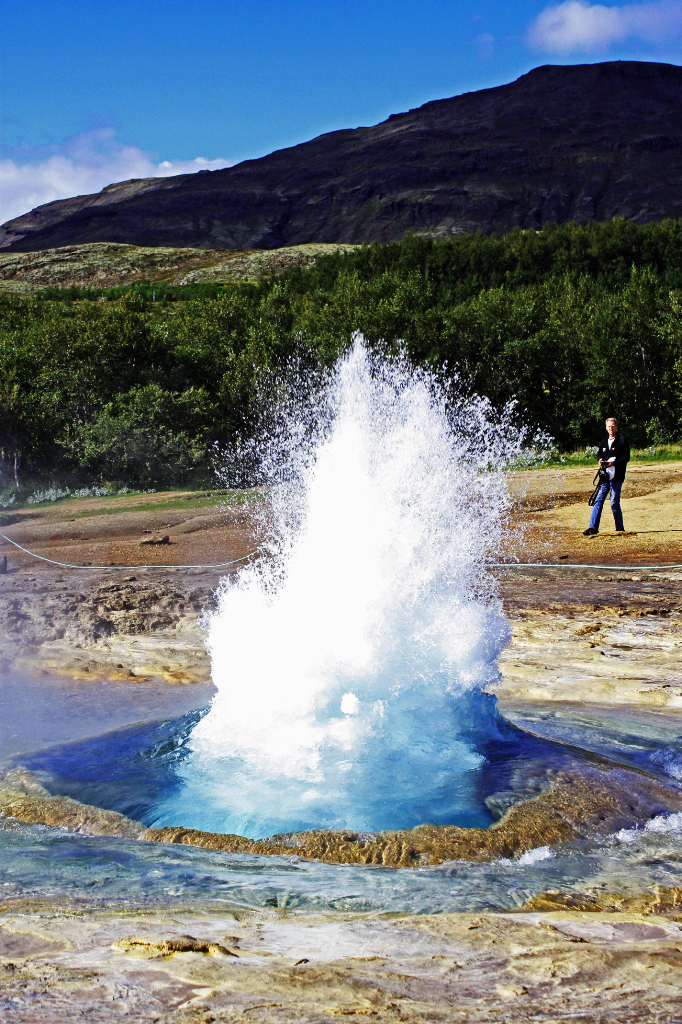 Catching Strokkur erupting in Geysir on the Golden Circle tour in Iceland Mallory On Travel adventure, photography