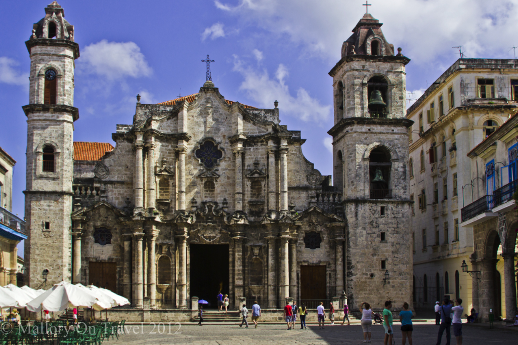 Tourist versus traveller; Church in the Old Town of Havana in Cuba in the Caribbean on Mallory on Travel adventure photography