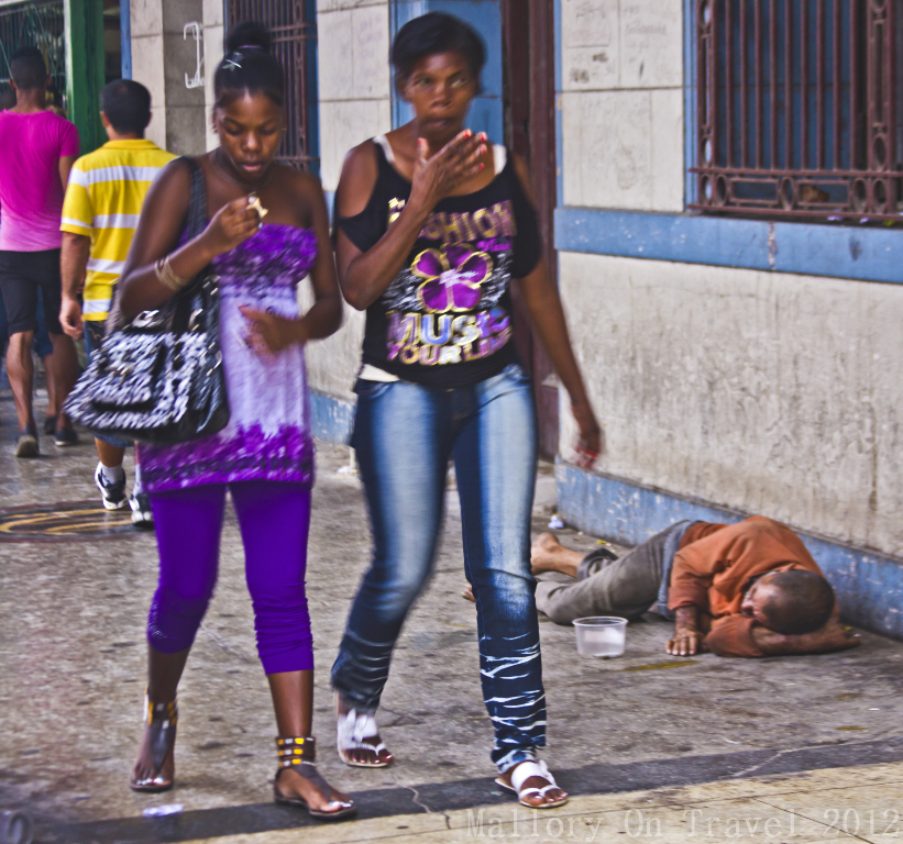 Volunteering can help the homeless sleeping on the streets cities like Havana on Cuba in the Caribbean is just ignored by passers-by on Mallory on Travel adventure photography