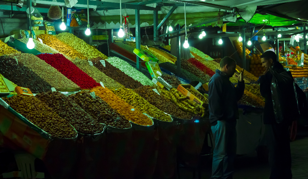 The stalls of the Marrakech's famous square Djemaa el Fna in Morocco on Mallory On Travel adventure, travel, photography
