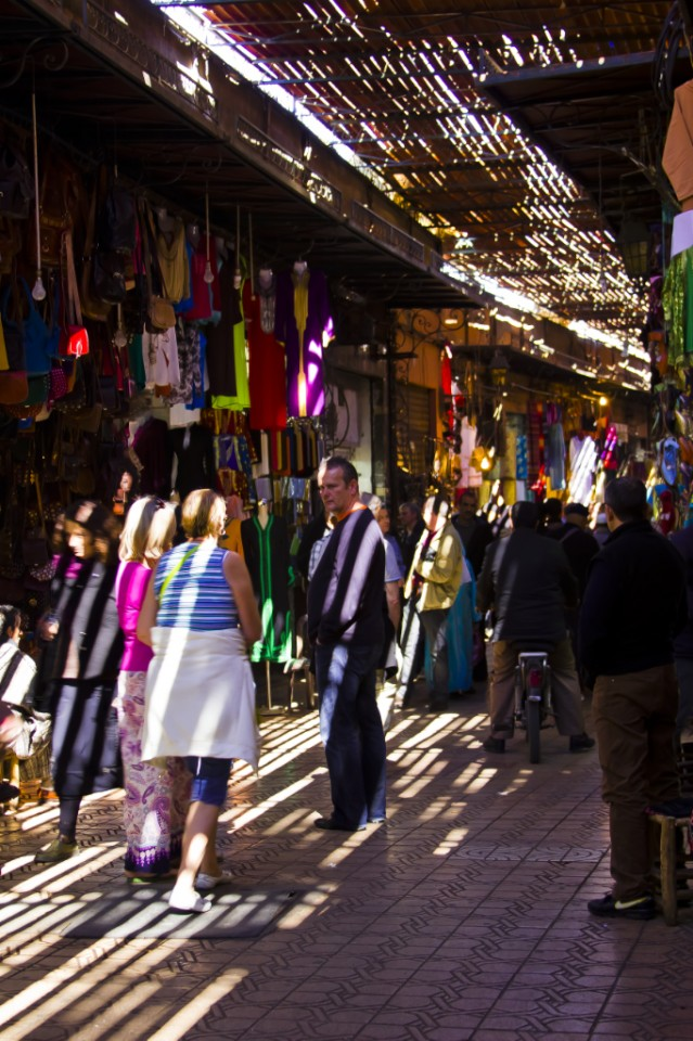 Haggling for souvenirs in the Marrakech souks, Morocco Copyright © by Mallory On Travel 2011 adventure, photography