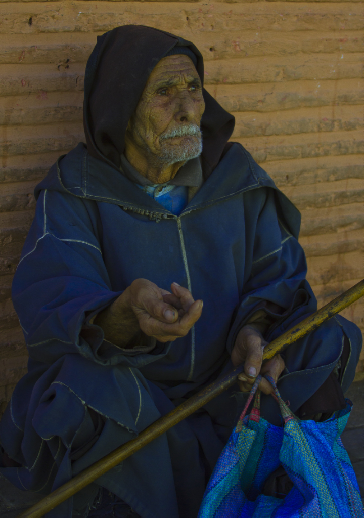 An old man begging in the median of Marrakech near Djemma el Fna on Mallory on Travel adventure, photography