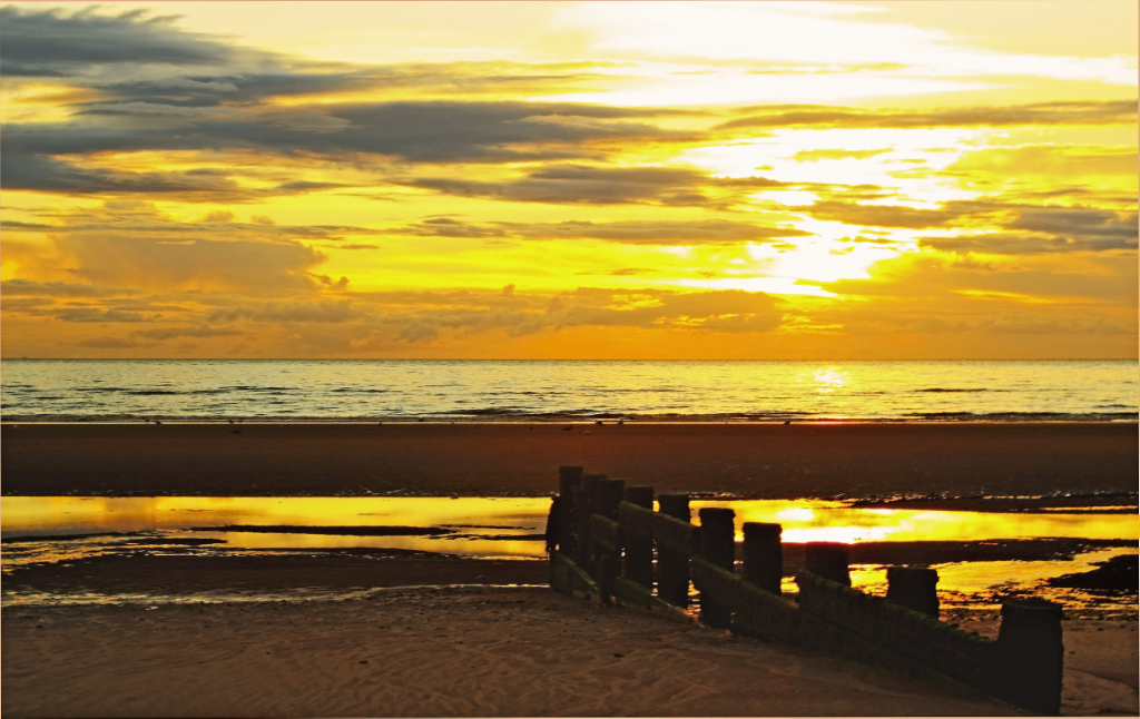 A quiet Cleveleys beach at sunset, near Blackpool, Lancashire in Great Britain on Mallory on Travel adventure, photography