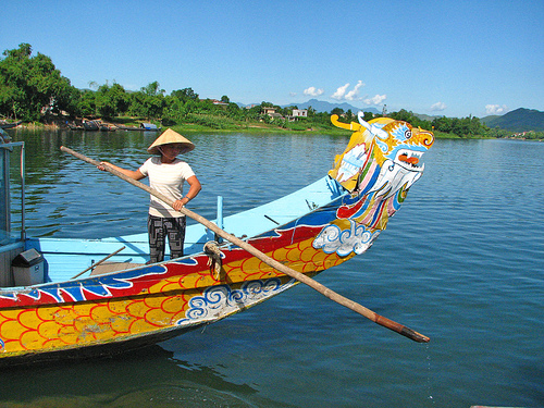 Cambodia to Vietnam; Dragonboat in Vietnam on Mallory on Travel adventure photography