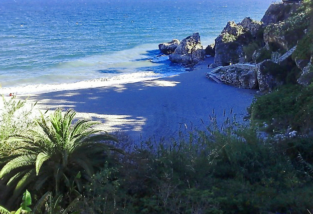Small cove on the beach at Nerja, Spain on Mallory on Travel, adventure, photography