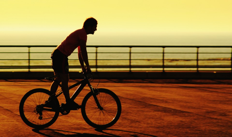 Journeying; Riding a bike at sunset in the Lancashire resort of Blackpool on Mallory on Travel, adventure, photography