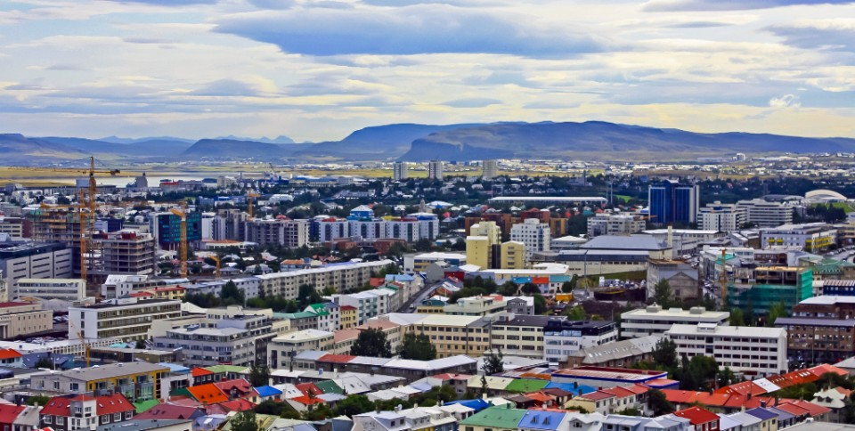 View over Reykjavik, Iceland with Mount Esja on the horizon on Mallory on Travel, adventure, photography