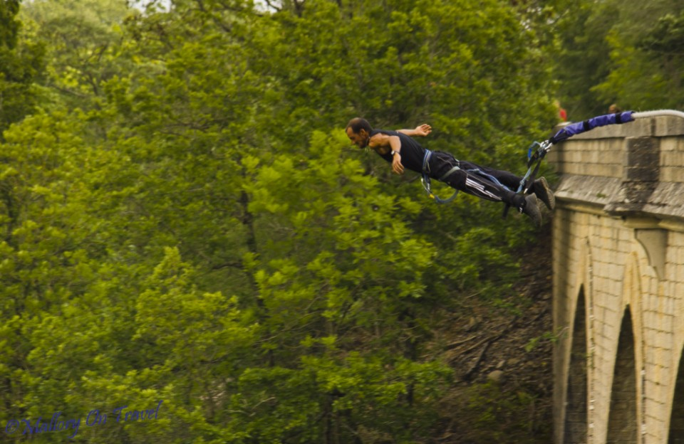 Adventurer takes the plunge on a bungee jump in the French Aveyron on Mallory on Travel, adventure, photography