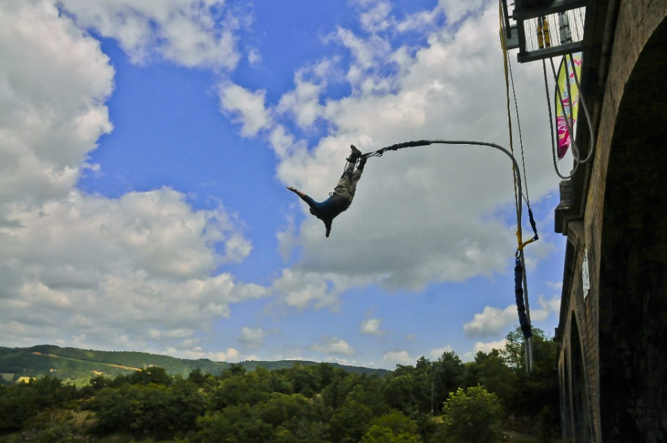 Freefall bungee jumping of a French bridge in the Aveyron near Millau on Mallory on Travel adventure photography