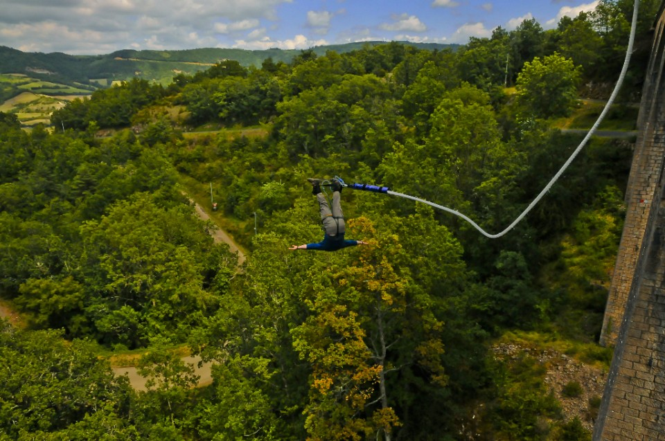 Bungee jumping and bouncing around off the viaduct near Ste Eulalie de Cernon in the French Aveyron on Mallory on Travel, adventure, photography