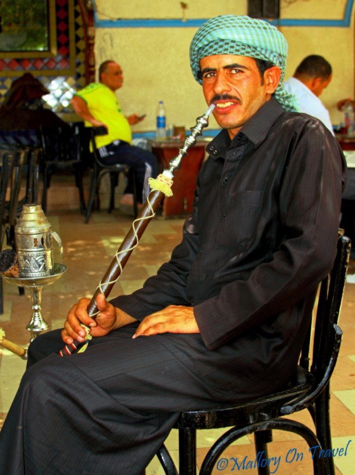 Egyptian gentleman enjoying a shisha with his coffee on Mallory on Travel, adventure, photography