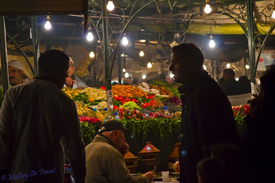 Buying street food in Djemaa el Fna, Marrakech, Morocco on Mallory on Travel, adventure, adventure travel, photography