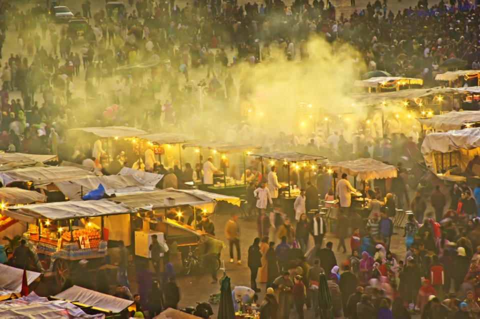 The population of Marrakech's Djemaa el Fna, Morocco, North Africa on Mallory on Travel, adventure, adventure travel, photography