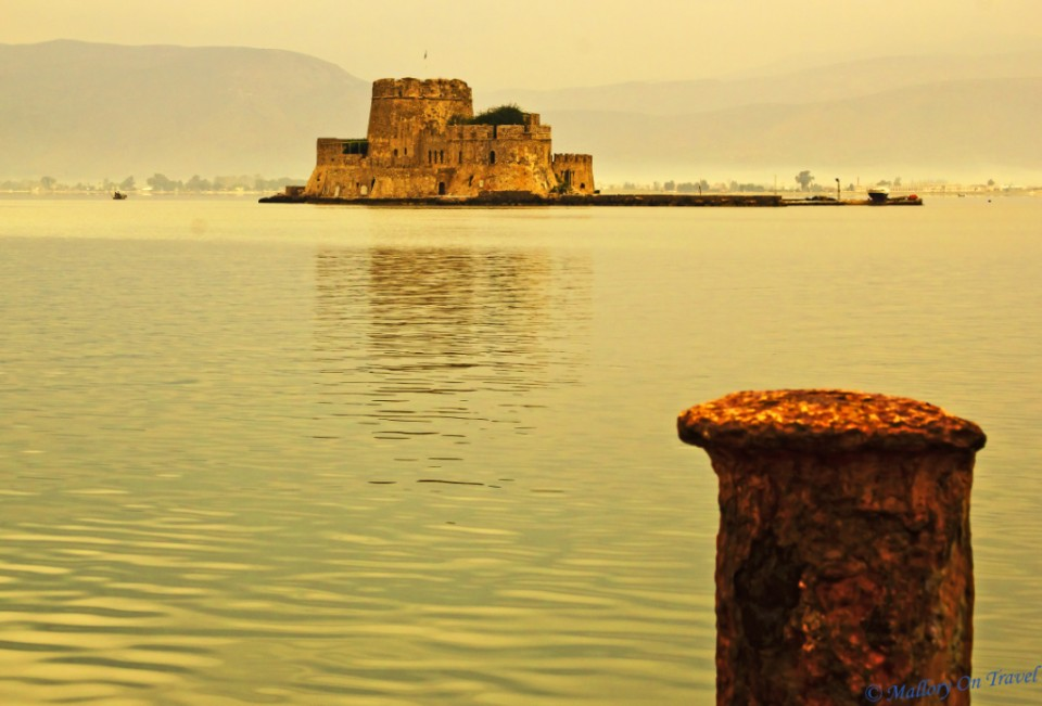 Nafplio is part of the Argolic Gulf, Bourtzi castle an island in the harbour in the Peloponnese region of Greece on Mallory on Travel, adventure, adventure travel, photography