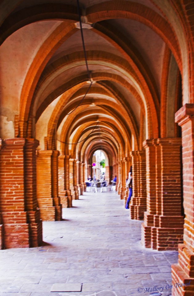 Exploring the archways of Montauban in the French region of Poitou-Charentes on Mallory on Travel, adventure, adventure travel, photography