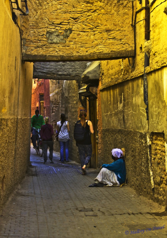 Tourists exploring the medina in Marrakech in North African Morocco on Mallory on Travel, adventure, adventure travel, photography