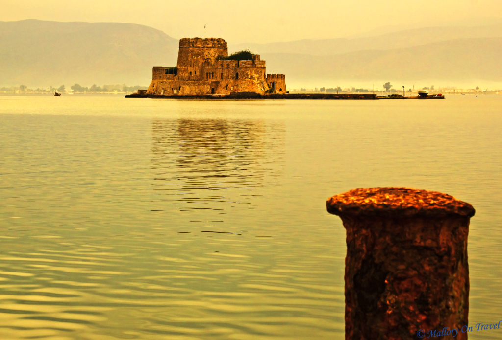 The Venetian fortified island of Bourtzi in Nafplio harbour Peloponnese Greece on Mallory on Travel, adventure, adventure travel, photography