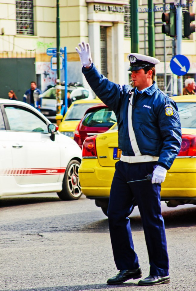 Greek traffic police at Piraeus, the port of Athens in Greece on Mallory on Travel, adventure, adventure travel, photography
