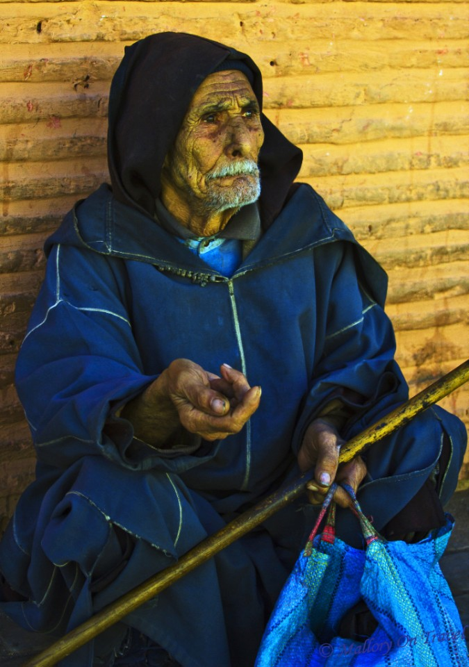 Berber beggar in the medina of Marrakech, Morocco on Mallory on Travel, adventure, adventure travel, photography