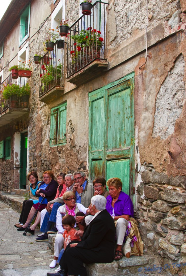 Locals taking a break from the sardana festival in Setcases, Catalonia, Spain on Mallory on Travel, adventure, adventure travel, photography