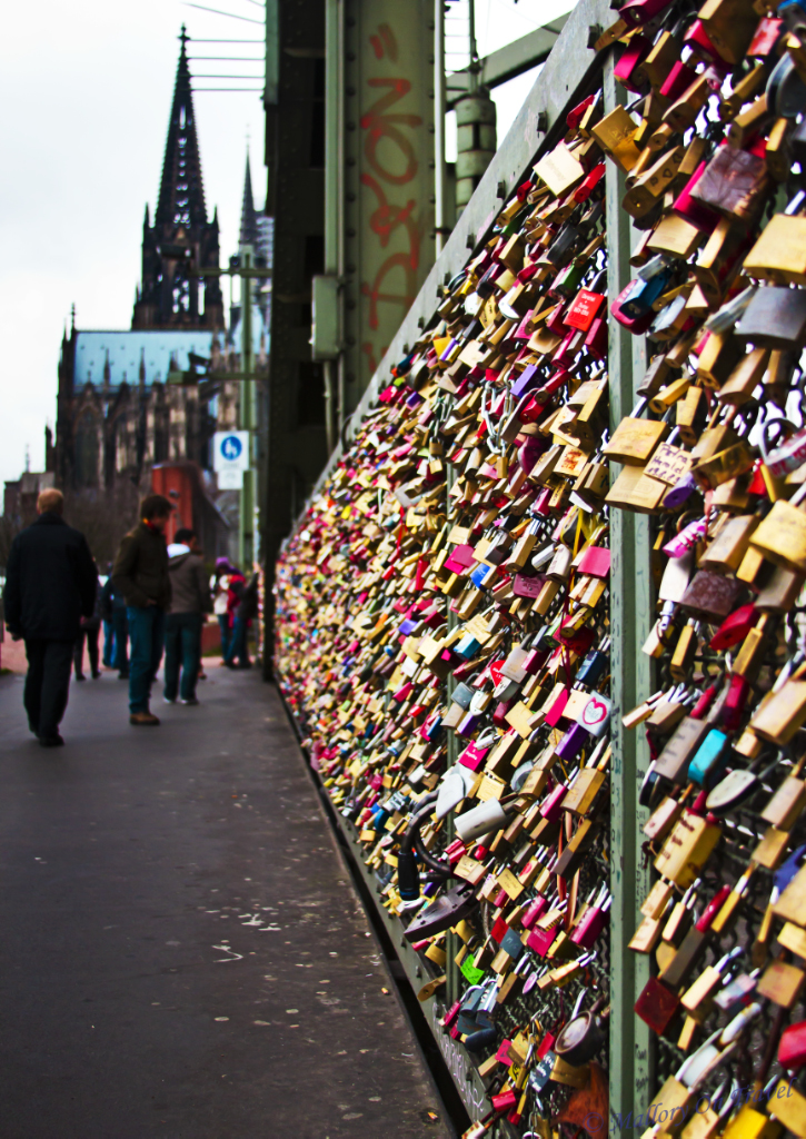 Padlocks of love on the railway bridge of locks in Cologne on Mallory on Travel, adventure, adventure travel, photography