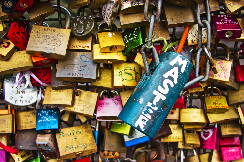 Lots of love locks on Cologne bridge of locks over the Rhine, Germany on Mallory on Travel, adventure, adventure travel, photography