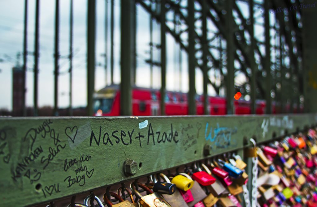 Trains and love locks on the bridge of locks over the River Rhine in Cologne, Germany on Mallory on Travel, adventure, adventure travel, photography iain_mallory_06704