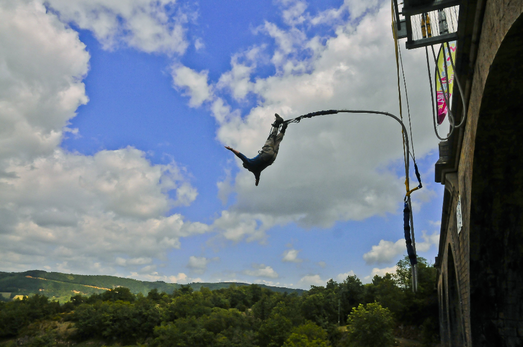 Jumping of a French bridge in the Aveyron near Millau  on Mallory on Travel, adventure, adventure travel, photography