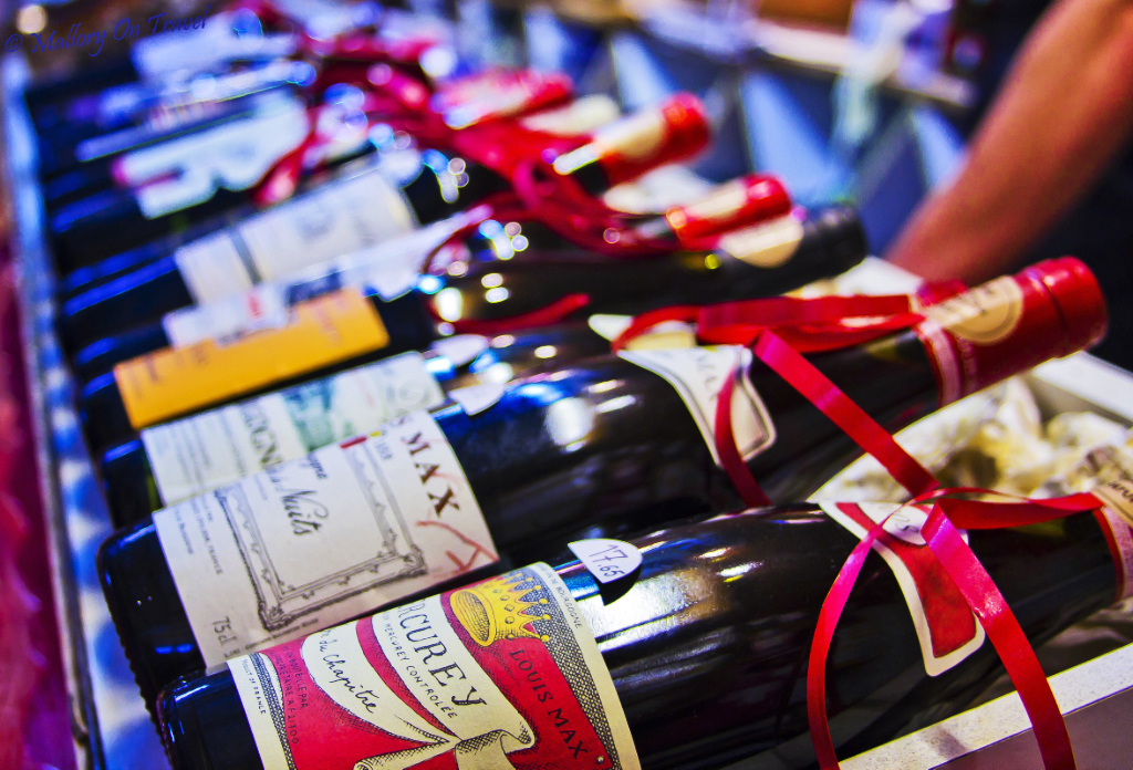 Wines and liquers in La Rochelle market  on Mallory on Travel, adventure, adventure travel, photography