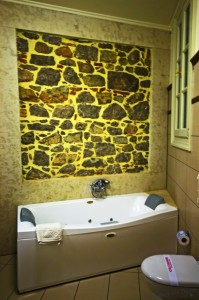 The luxururious spa bath in the Xenon Inn, in the Peloponnese city of Nafplio in Greece on Mallory on Travel, adventure, adventure travel, photography