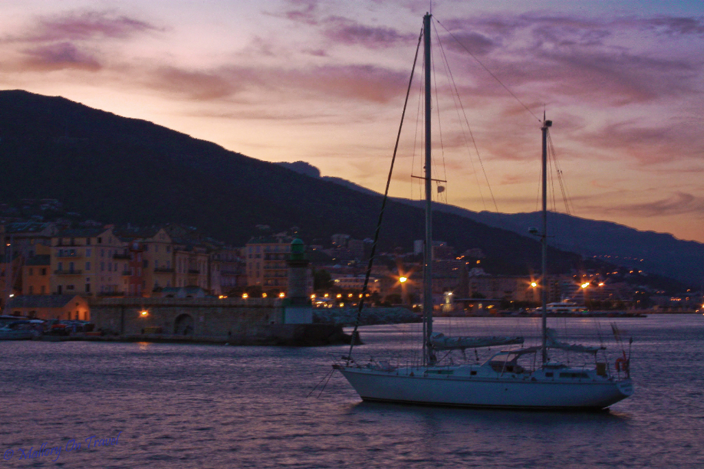 Island escapes; Sailing boat at sunset in Bastia, Corsica on Mallory on Travel, adventure, adventure travel, photography