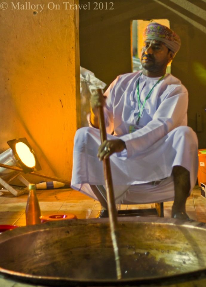 Molasses stirring at Oman's Muscat Festival in the Sultanate of Oman on Mallory on Travel, adventure, adventure travel, photography Iain-Mallory-348-2.jpg street_food