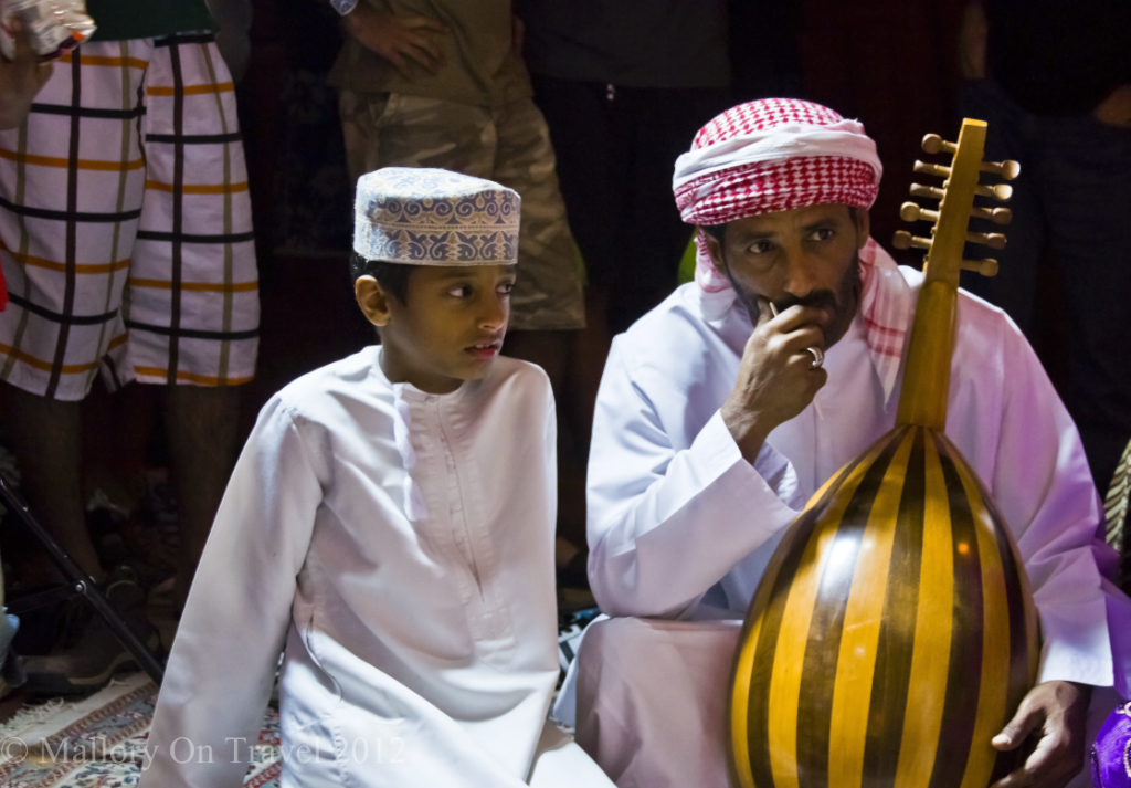 Bedouin family performers in the Omani desert at Wahiba Sands in the Sultanate of Oman  on Mallory on Travel, adventure, adventure travel, photography