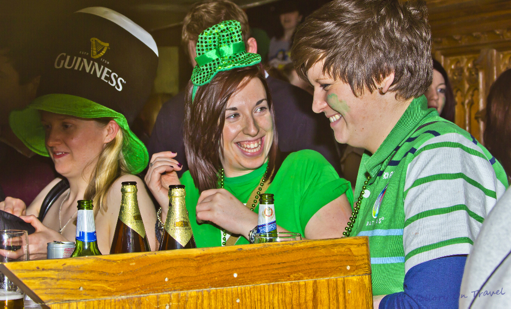 Girls celebrating in a Manchester pub on St Patrick's Day on Mallory on Travel adventure, photography