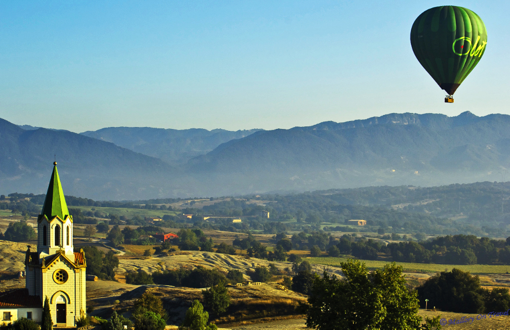 Ballooning; Drifting over the volcanoes of La Garrotxa in a hot air balloon in the Catalan, Spain on Mallory on Travel adventure, photography