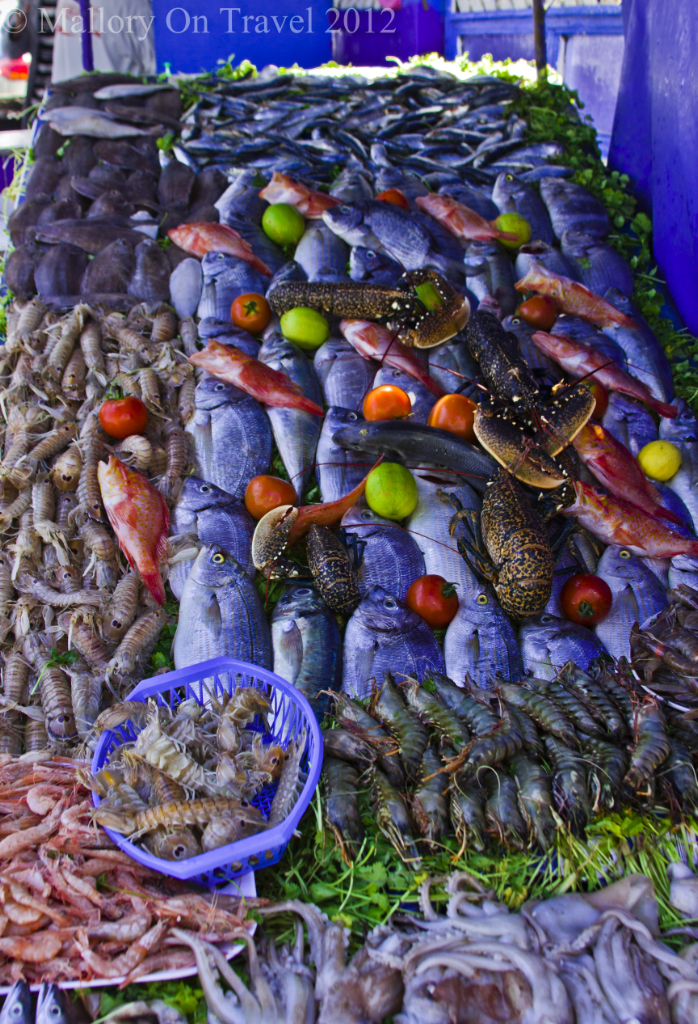 A streetfood seller seafood display in Essaouira, Morocco on Mallory on Travel, adventure, adventure travel, photography