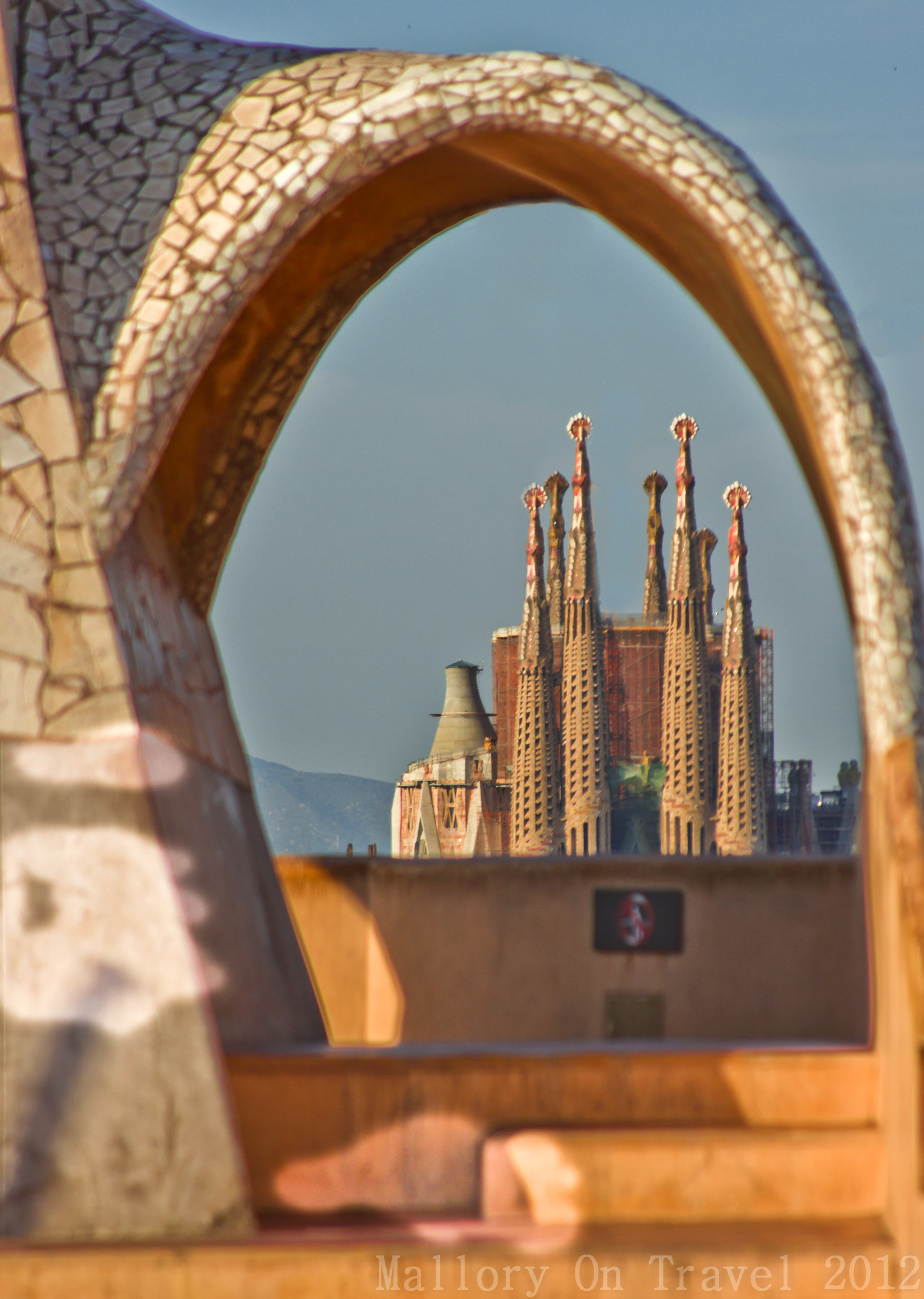 Places to visit in Spain; The view of the Sagrada Familia from the roof of Gaudi's La Pedera in Barcelona, Spain on Mallory on Travel adventure photography