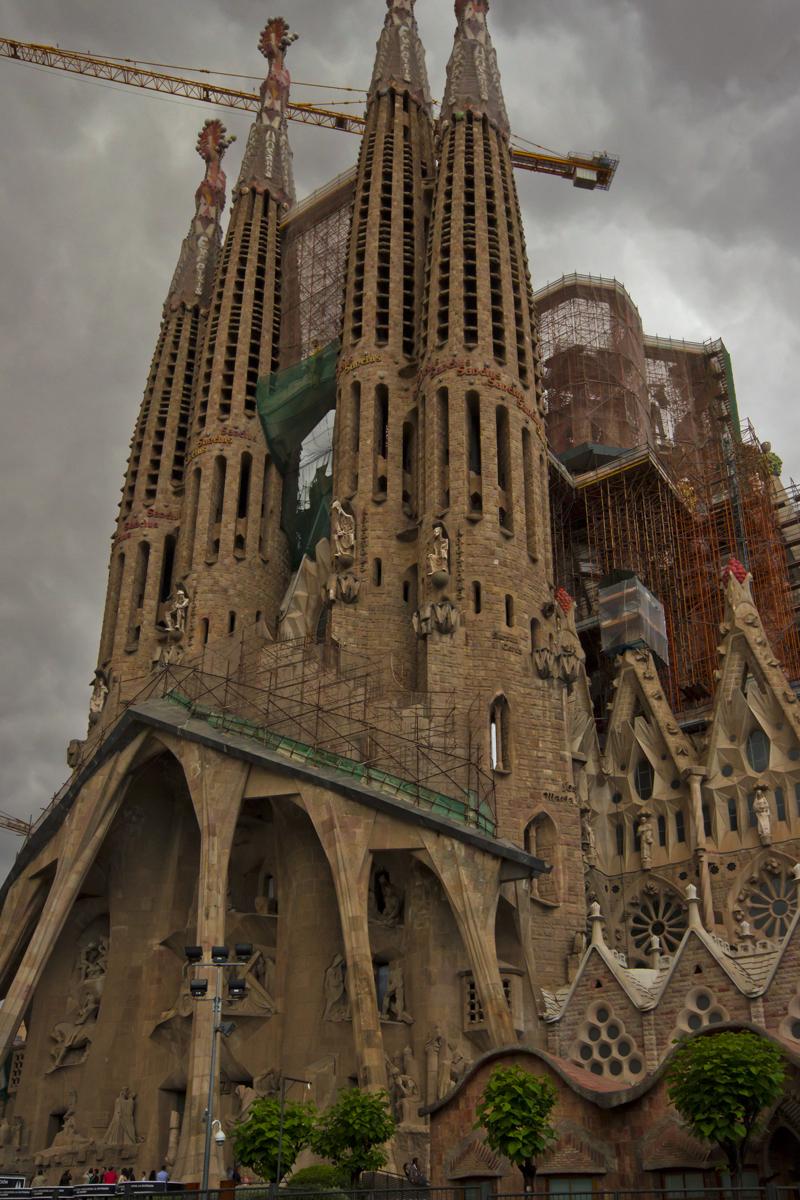 Cranes tower over Gaudi's Sagrada Familia in Catalonain Barcelona, Spain on Mallory on Travel adventure photography