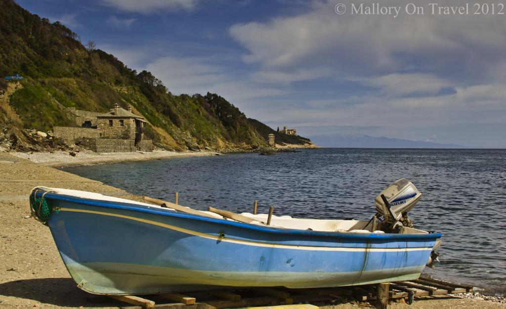 Fishing boat near Iviron Monastery Mount Athos, Halkidiki in Greece on Mallory on Travel adventure photography