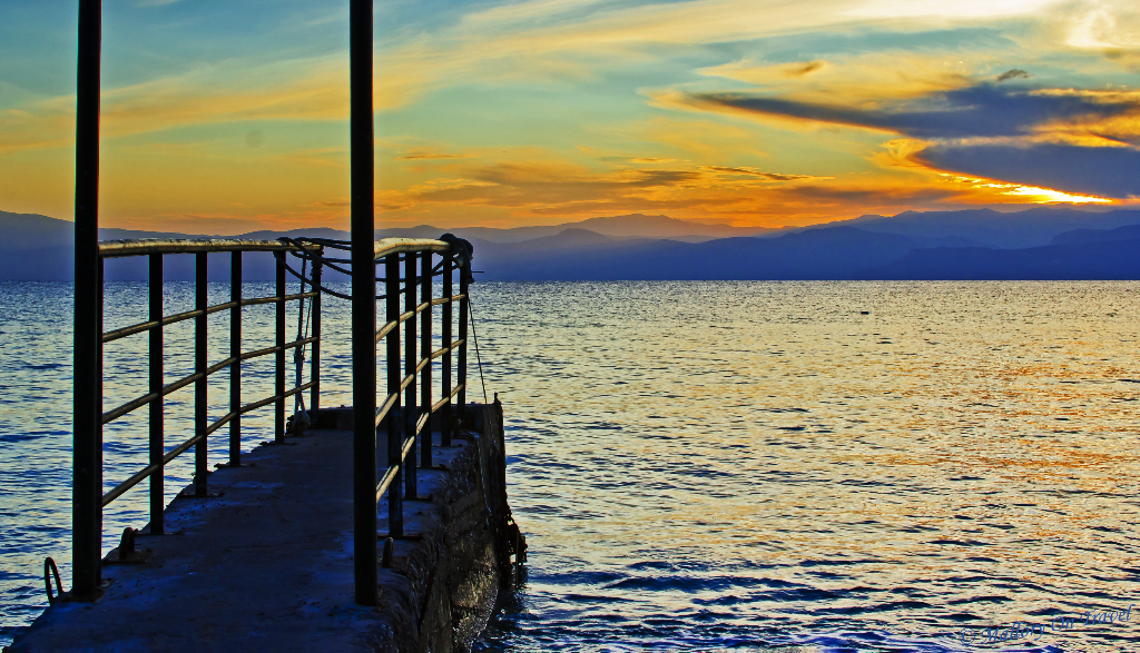 A lonely jetty at sunset on the Greek Saronic Island of Spetses near Athens on Mallory on Travel adventure photography