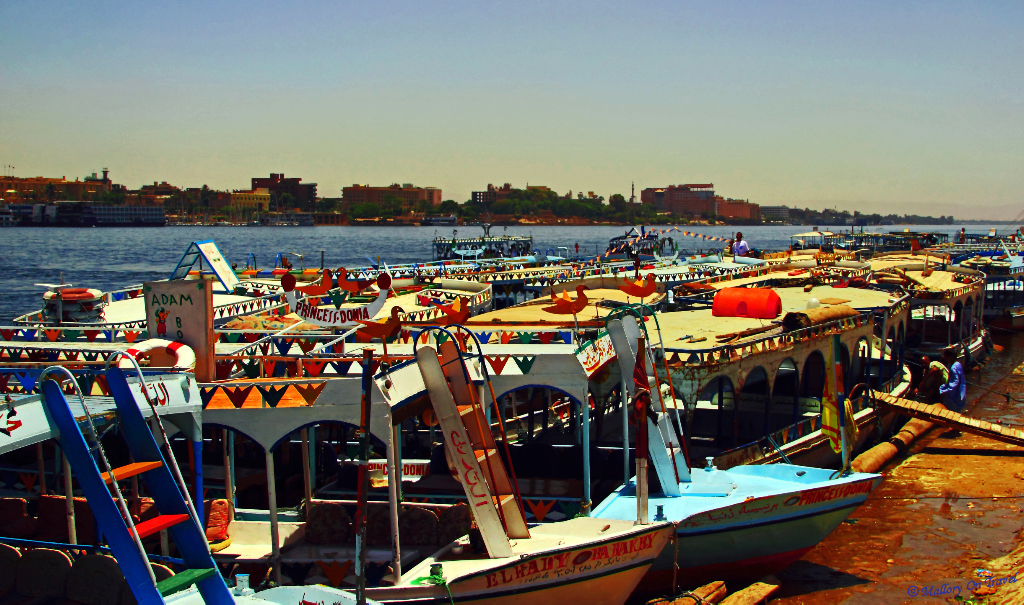 Colourful cruise boats moored on the Nile at Cairo Egyptian capital on Mallory on Travel adventure photography